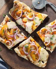 Peach and PepperJack Flatbread- Get a taste of fruit, spice, and everything nice this summer with this unique flatbread topped with Pepper Jack cheese, grilled peaches and spicy Sriracha sauce.