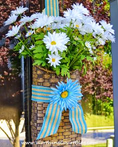 A door basket filled with daisies for summer.  A door basket is so versatile.  It's easy to simply change what is displayed during the diffe...