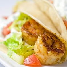 Looking for the perfect, light summer supper? Try these spicy shrimp tacos with cool cilantro-lime sour cream.