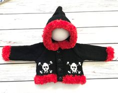 A personal favourite from my Etsy shop https://www.etsy.com/uk/listing/570237819/baby-gothemopunk-hand-knitted-skull