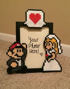 A personal favorite from my Etsy shop https://www.etsy.com/listing/267855691/mario-and-princess-peach-wedding-picture