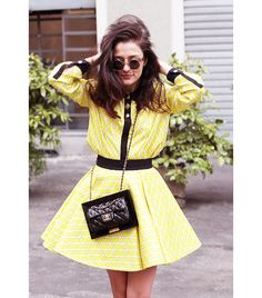 Little Miss sunshine   @Who What Wear - Eleonora Carisi of Jou Jou Villeroy  On Carisi: Fausto Puglisi top, skirt, and shoes; Chanel bag