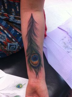 ts a Peacock feather and the meaning behind is in greek mythology it has to do with wisdom and knowledge and also they are used to help you seek balance in life. inked-wonder