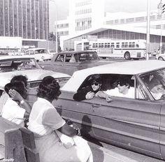 John Lennon & Paul McCartney talking to a couple of girls in Miami, 1964