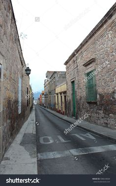 Morelia, Michoacan / Mexico - July 2012: A street in Morelia.  #stock #stockphotos #stockimages #nature #background #photos #mexico #travel #photography #alley