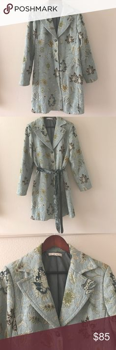 CAbi Guinevere Jacobean Tapestry Brocade Coat Beautiful floral print in shades of teal, gold, green and creme. 3 gold metal fleur de lis embossed buttons, fully lined inside. Teal velvet belt that can be tied in front or back. Vented sleeve cuffs can be worn up or down! In excellent condition! CAbi Jackets & Coats Trench Coats