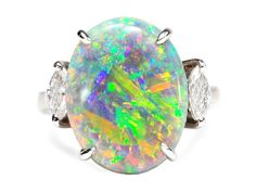 Symphony of Color: Black Opal Diamond Ring - 4.69 carats. Set in 18k white gold and accented on the sides with a pair of marquise diamonds with a total estimated weight of .20 carats. $44,500 USD