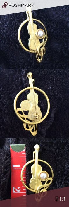 Musical instrument fashion pin New, never worn violin and G-clef fashion pin with faux pearl accents. Gold tone is more of a satin or brushed finish and not shiny. Jewelry Brooches