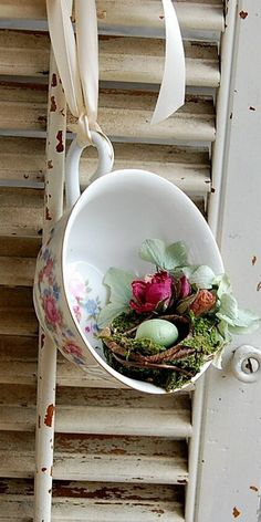 Ribbon tied to adorable teacup with a birdnest .... cute idea for Easter too!