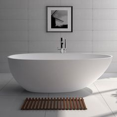 The is a large simple, yet stylish bathtub with a modern curved oval design. The is the largest of its series. Size: L x W x H in Material: Solid Surface/Stone Resin Color/Finish: Matte White (Glossy Optional) Weight: lbs Water Capacity: 98 Gal Small Bathtub, Small Bathroom, Master Bathroom, Navy Bathroom, Bathroom Sets, Modern Bathroom Design, Modern House Design, Stone Bath, White Bathroom Cabinets