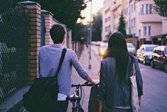 Write about the above picture. Are they a couple? Friends? Siblings? Or did they only just meet? What city do they live in? Are they coming home from somewhere, or going somewhere? Is it her bike or his?
