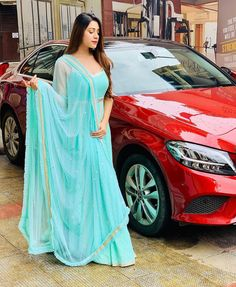 Image may contain: one or more people, people standing and car Beautiful Suit, Beautiful Dresses, Beautiful Women, Indian Dresses, Indian Outfits, Wedding Hijab Styles, Hiba Nawab, Gown Party Wear, Bridal Lehenga Choli