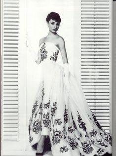 This gorgeous strapless white organdy gown, embroidered by hand with black and white flowers, with attached train, was not the creation of legendary film costumer Edith Head — even though she won the Oscar for it. Rather, it was the work of designer Hubert de Givenchy. Called, The Sabrina Dress, it was worn by Audrey Hepburn in the 1954 movie, SABRINA.  Utterly splendid!