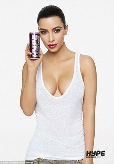 Kim Kardashian flaunts her cleavage and tiny waist in futuristic shoot #dailymail