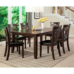 """7-Pc. Dinette. This beautiful table and chair set will complete your dining room setting. Highlighted by four tall legs, the rectangular table features an 18"""" butterfly leaf to accommodate larger gatherings of friends and family. Showcasing an elegantly-styled back, the six accompanying side chairs feature upholstered seats for extended comfort and support. All completed with a dark brown finish, this table and chair set will transform your transition dining space."""