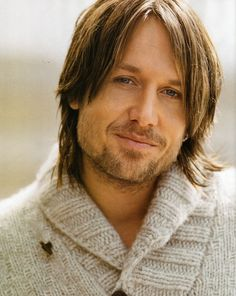 I have zero, and I mean *zero*, interest in country music, but I still think Keith Urban is pretty hot.  Must be the square jaw.