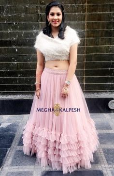 In awe with our client who carried off a pink frill skirt with a wrap crop top. Cotton Frocks For Kids, Crop Top Designs, Fashion Illustration Dresses, Lehnga Dress, Indian Gowns Dresses, Lahenga, Ethnic Outfits, Lehenga Designs, Indian Wedding Outfits