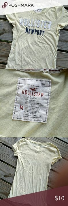 Yellow Hollister shirt Yellow Hollister shirt with white and navy blue writing. Great condition.   Size medium. Hollister Tops Tees - Short Sleeve