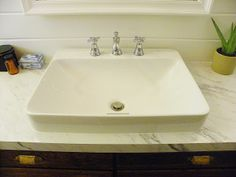 love this sink - Kohler K-2660-8-0 Vox Rectangle Vessel with Faucet Deck, White
