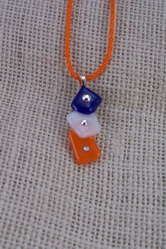 Bronco Pendant Blue & Orange Fused Glass with Crystal accents handmade jewelry. $15.00, via Etsy.