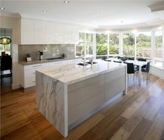 Best Design Ideas Of Stunning Modern Kitchens. Divine Rectangle Shape Marble Kitchen Island featuring Stunning Modern White Gloss Kitchen Cabinets and Undermount Sink Gloss Kitchen Cabinets, White Gloss Kitchen, Kitchen Countertops, Island Kitchen, Taupe Kitchen, Beige Cabinets, White Cupboards, Quartz Countertops, Home Decor Kitchen