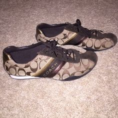 Coach Tennis Shoes Brown/Tan tennis shoes. I bought these from another Posher thinking I'd LOVE them but they're a bit too big.  I wore them twice and got them basically new. Coach Shoes Sneakers