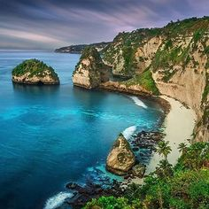 Atuh Beach, Nusa Penida, Bali, Indonesia. Atuh Beach is tranquilly situated at beautiful bay with natural white sand, surrounded by hills and has a cliff wall.