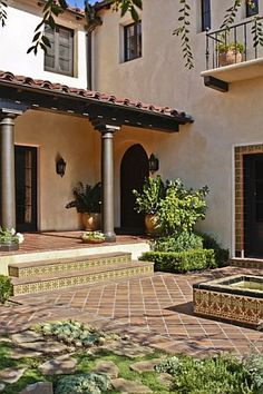 Dress up a bland exterior. Create spanish style with columns and overhang