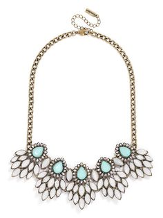 Peacock teardrops are the focus of this sparkling statement necklace affixed with tons of clear crystal marquise stones in a three-dimensional silhouette.