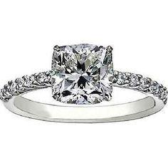 Cushion cut diamond on skinny diamond band.. Perfect