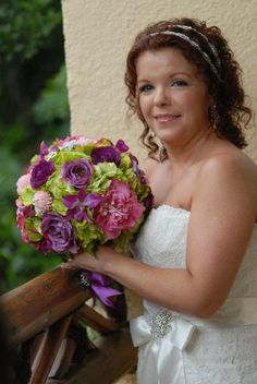 Purple, green, and pink bridal bouquet featuring peonies, roses, garden roses, hydrangea, orchids, and more. Floral design: Something Floral / Something Spectacular. Materials: Realistic, silk/artificial flowers and foliage. #wedding