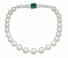 A MAGNIFICENT AND RARE NATURAL PEARL, EMERALD AND DIAMOND NECKLACE The single-strand composed of twenty-three slightly graduated natural pearls, measuring approximately 13.7 to 10.4 mm, to the pear-shaped diamond and cushion-shaped emerald clasp, mounted in platinum and gold, 38.5 cm