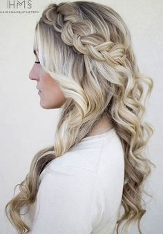 6 blonde curly hairstyle with a Dutch crown braid