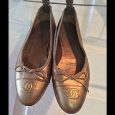 Chanel ballerina bow flats gold Cute gold ballerinas in good condition, soft lamb leather with leather soles CHANEL Shoes Flats & Loafers