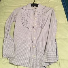 Banana Republic button up ruffle shirt Brand new without tag. Great condition. Thin plaid and ruffles at the top. Great with slacks, pencil skirt, nice jeans, black pants. Would wear to work or unbutton with tank underneath. Banana Republic Tops Button Down Shirts