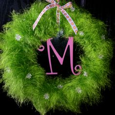 Wreath I made. Got the idea off pinterest except I added the letter.(painted a wooden M and attached with fishing line.)