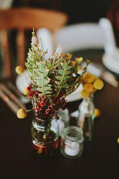 Australian wildflower centerpieces, photo by Brittany Esther http://ruffledblog.com/australian-yacht-club-wedding #weddingflowers #craspedia