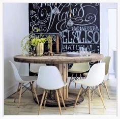 Dining setting with wooden repurposed cable wheel table. #recycled