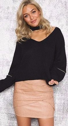 A black sweater is perfect to combine with nude details.