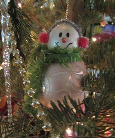 2005 Another snowman. wooden head, glass body, fabric scarf, pom pom ear muffs