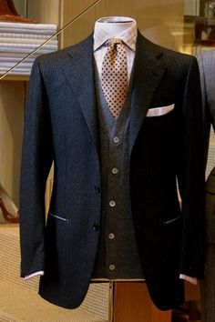 charcoal gray pinstriped blazer. gray cardigan. beige plaid oxford. tan/terracotta patterned tie. white pocket square. southern. country. style.