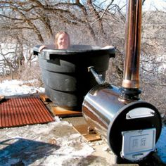Country Lore: Wood-Fired Hot Tub - DIY - MOTHER EARTH NEWS. I'd want a much bigger tub of course, so this might not work, but it's something that could be a luxury waaaaaay down the line after building the house.