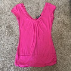 Pink v-neck front and back tee size medium Has very tiny hole along left seam. Otherwise like new.    **all my clothes have been lightly worn and VERY well taken care of** Self Esteem Tops Tees - Short Sleeve