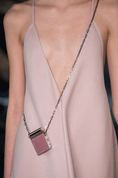 Micro Bags Are Getting Smaller & Smaller #refinery29  http://www.refinery29.com/2016/10/125135/valentino-baby-bags-pfw-spring-2017#slide-6  Stick to a solid color......