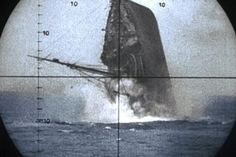 Allied vessel sinking...seen through periscope of a German submarine.