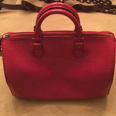 Louis Vuitton Speedy 30 Epi leather red handbag This authentic Louis Vuitton Epi leather Speedy 30 Boston handbag is in good condition and is attractive to the eye. A perfect gift for Valentine's Day or any occasion. Louis Vuitton Bags Shoulder Bags
