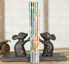 """Adorable cast iron mice bookends!Each cast iron bookend is 4""""W x 3½""""D x 4""""T.Accessories are not included FREE SHIPPING!"""