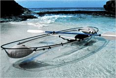 transparent kayak! yes please.  as long as we're looking at coral and clownfish and not water snakes.