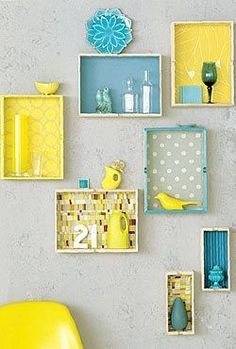 Such a cute idea to use old drawers for displaying fun little treasures.  Love the colours too.