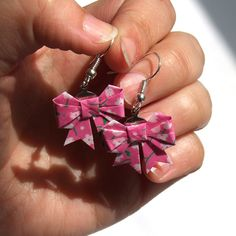 Origami bow earrings, made with pink with flowers origami washi paper. $7.50, via Etsy.